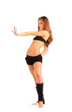 Girl stands and pulls arm forwards Royalty Free Stock Photos