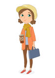 A girl stands in street clothes and holding a Cup of coffee and a laptop bag. Royalty Free Stock Photography