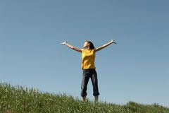 Girl stands at top of a hill Stock Image