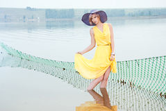 A girl stands in the water Royalty Free Stock Images