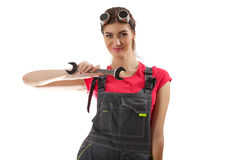 The girl stands with a wrench Royalty Free Stock Photography