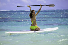 Girl on a standup paddle board Royalty Free Stock Photos