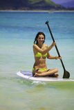 Girl on a standup paddle board Stock Photo