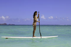 Girl on a standup paddle board Royalty Free Stock Photography