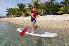 Girl Standup Paddle Boarding Stock Images