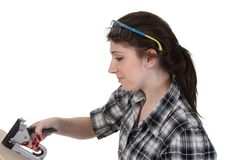 Girl with a staple gun Stock Photography
