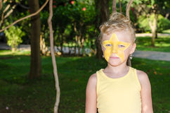 Girl with star face painting Royalty Free Stock Image