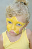 Girl with star face painting Stock Image