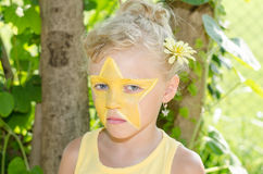 Girl with star face painting Royalty Free Stock Photography