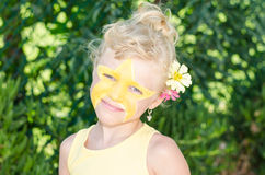 Girl with star face painting Stock Photo
