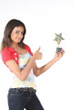 Girl with star trophy Royalty Free Stock Image