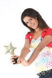 Girl with star trophy Stock Photo