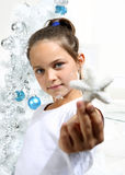 Girl with staras tree Royalty Free Stock Photo