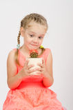 The girl stares at a cactus in pot Royalty Free Stock Photos