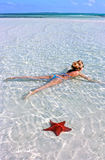 Girl with a starfish Royalty Free Stock Image
