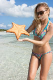 Girl with a starfish Stock Images