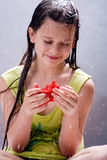 Girl with starfish Stock Images