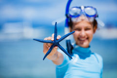 Girl with starfish Royalty Free Stock Image