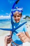 Girl with starfish Stock Photo