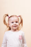 Girl Staring. Emotional portrait of a little girl staring in awe, vertical studio shot Royalty Free Stock Photography