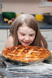 Girl staring at pie Stock Photography