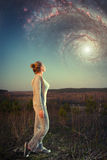 Girl and a starry sky. Stock Images