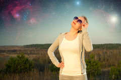 Girl and a starry sky. Royalty Free Stock Photos