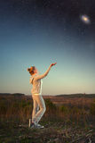 Girl and a starry sky. Royalty Free Stock Photo