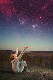 Girl and a starry sky. Stock Photography