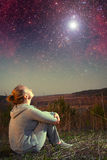 Girl and a starry sky. Stock Image