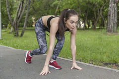 The girl at the start position. The girl is Jogging in the Park Stock Images