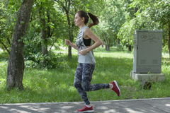 The girl at the start position. The girl is Jogging in the Park Stock Image
