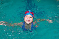 Girl start to swimming pool. Happy school girl start to swimming pool Royalty Free Stock Photo