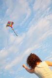 Girl starting kite Royalty Free Stock Photography