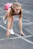 Girl starting to run. Preteen girl starting to run on track Royalty Free Stock Photo