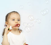 The girl starting up soap bubbles Royalty Free Stock Photos