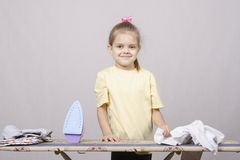 The girl starts to iron Stock Photo