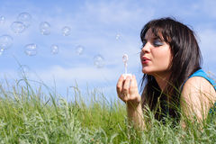 Girl starts up soap bubbles Stock Image