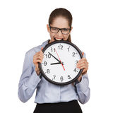Girl in a state of stress bites the clock Stock Photography