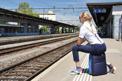 Girl at the station Stock Photo