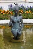 Girl statue fountain in Mirabell gardens Stock Photo