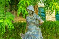 Girl statue in Supetar stock images