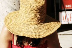 The girl in the staw hat. Taking it easy and ducking away from the sun Royalty Free Stock Photo
