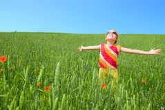 Girl stay at green field Royalty Free Stock Images