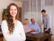 Girl staying near family members Stock Photography