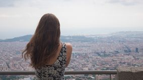 Girl staying on observation deck. Barcelona city aerial view. City overview. Breathtaking view stock images