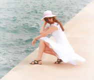 Girl stays in sea waves Royalty Free Stock Images