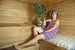 Girl is steamed in  sauna Royalty Free Stock Image