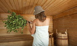 Girl is steamed in the sauna Royalty Free Stock Photography