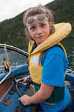 Girl steering  boat Stock Image